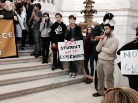 Students with the Providence Student Union dressed as guinea pigs demonstrate at the Statehouse.