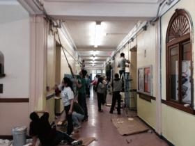Dozens of volunteers paint a hallway in Goff Jr. High School in Pawtucket in honor of Martin Luther King Jr, Day.