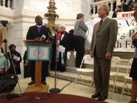 Governor Lincoln Chafee at the interfaith vigil on poverty at the Statehouse.