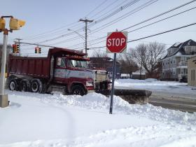 A snow plow clears streets in Cranston.