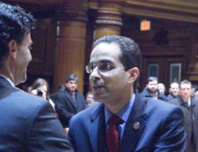 Providence Mayor Angel Taveras shakes hands at his final state of the city address.