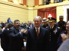 Zainyeh, at left, applauds Governor Chafee prior to the governor's 2013 State of the State address.