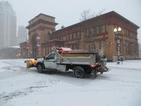 A plow shovels out the snow in downtown Providence.
