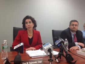 State treasurer Gina Raimondo and Retirement Board member Michael Robinson announce the 6-1 vote on the proposed pension settlement.