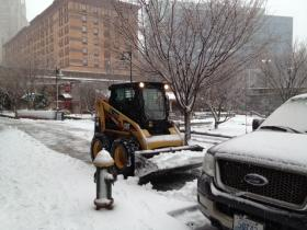 Plows remove snow in downtown Providence.