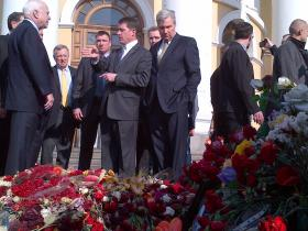 Senator Sheldon Whitehouse (center) looks down at a memorial in Maidan Square, alongside Senator John McCain (far left) and Senator Dick Durbin (yellow tie)