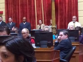 Marcello (right) listens during the vote for speaker