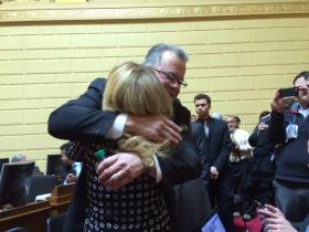 Mattiello hugs state Rep Doreen Costa (R-North Kingstown) prior to the vote for speaker