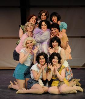 "Gerrianne Genga, as Dorothy Brock, is surrounded by the chorines in Ocean State Theatre's ""42 Street."""