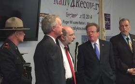 From left to right: State police chief Col. Stephen O'Donnell, Governor Lincoln Chafee, Health department director Dr. Michael Fine, Dept. of Behavior Health head Craig Stenning, and the Providence Center's Jim Gillen at a press conference Thursday at the Anchor Community Recovery Center in Pawtucket, discuss a reporter's question.