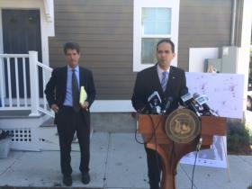 Attorney John Relman and Mayor Angel Taveras announce a federal lawsuit claiming Santander Bank engaged in discriminatory lending.
