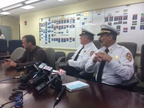 At a press conference Monday investigators with the Providence Fire Department said a single clamp holding up the performers snapped.