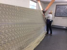 Laurie Roberts inspects every yard of lace before it goes out the doors of Leavers Lace.