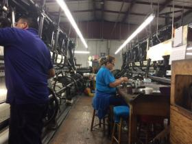 Workers at Leavers Lace in West Greenwich work on machines that are more than 100 years old.