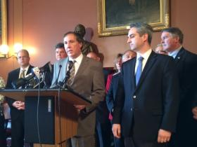 Lawmakers announce plan to zap Sakonnet River Bridge toll. House Finance Chairman Ray Gallison stands at the microphone.