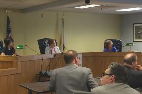 The office of the health insurance commissioner held a public hearing on health insurance rates on June 17; small business owners showed up in force.