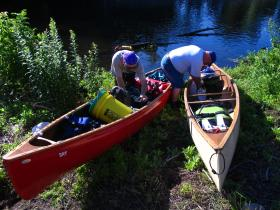 Chuck Horbert (left) and Jim Cole (right) prepare to embark on a canoe journey across Rhode Island. They expect to reach Westerly after traveling for 101 miles.