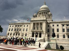 Liberians rallied at the Statehouse.