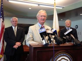 Warwick Mayor Scott Avedisian (left) with Governor Lincoln Chafee at T.F. Green Airport.