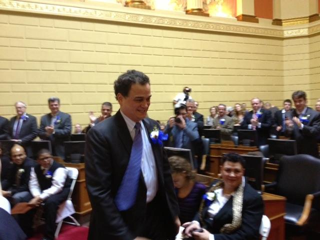 Gordon Fox makes his way to the rostrum after winning reelection