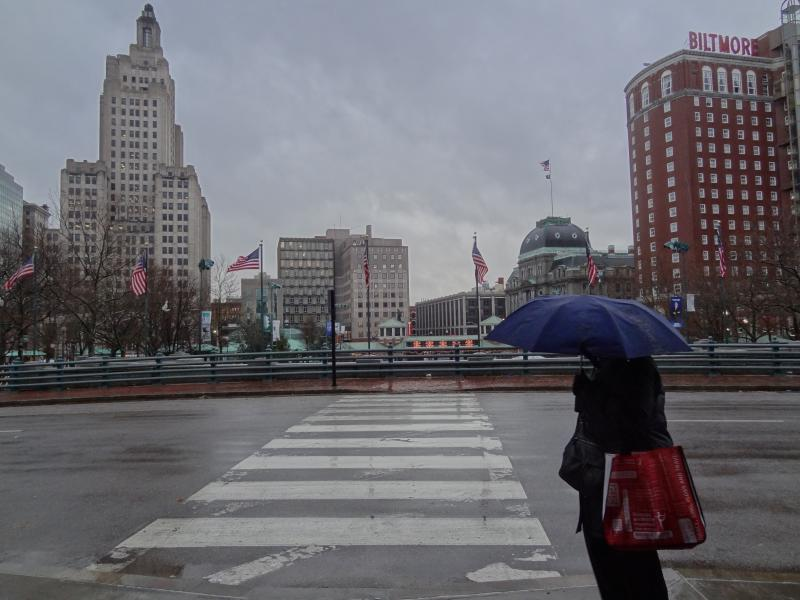 Pedestrian in rain, downtown Providence