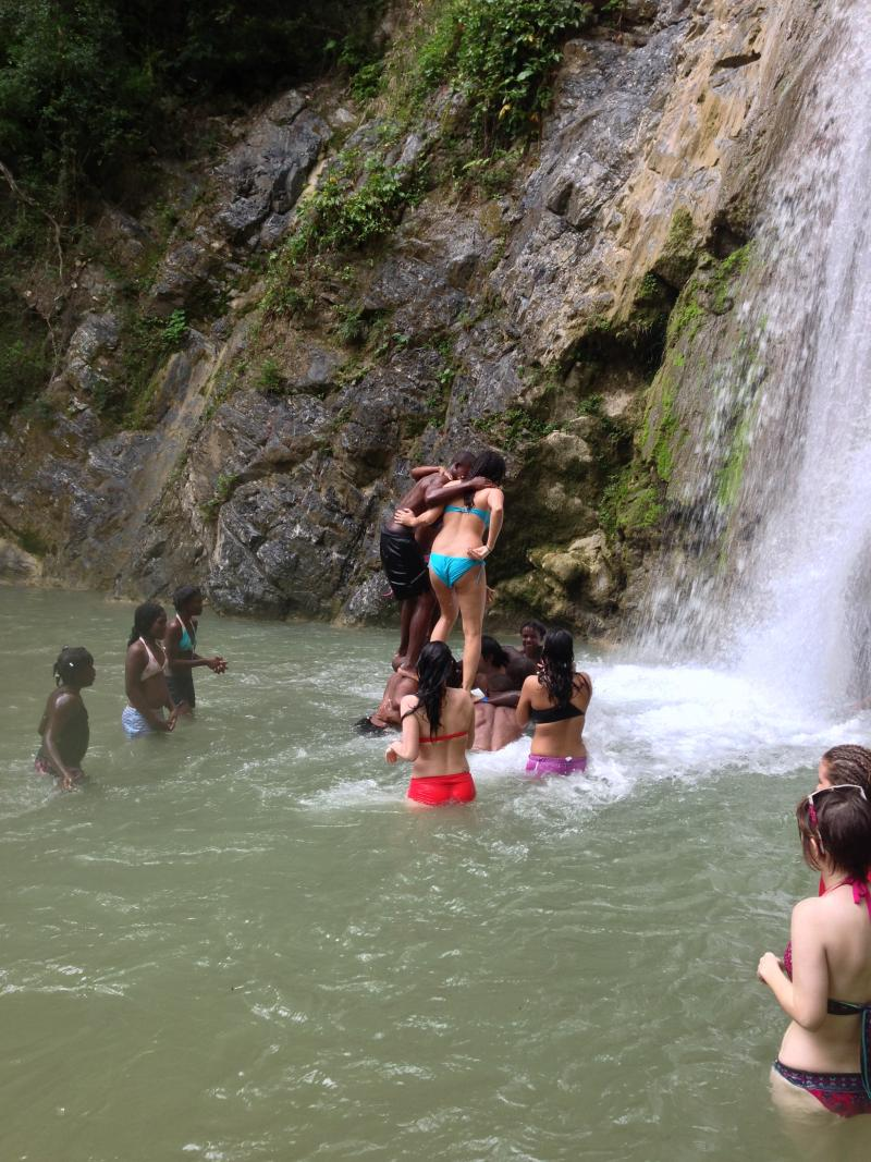 URI students hiking and swimming with new friends from The Batey