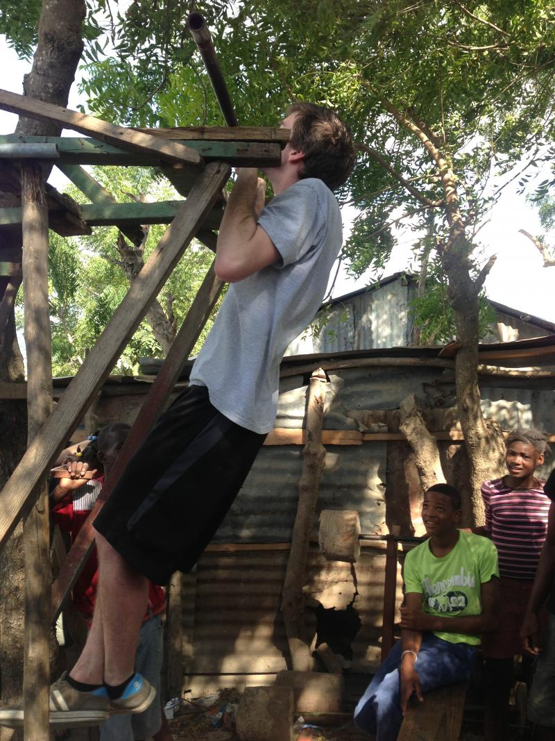 URI students working out with their hosts in the makeshift Batey gym
