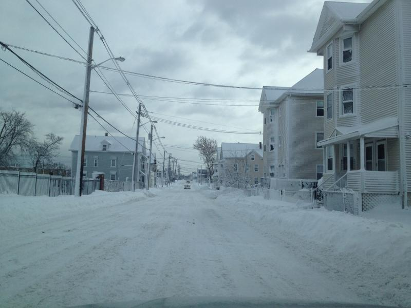 A Providence street plowed by covered with snow