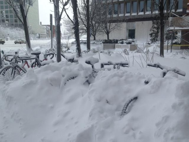 Snow drifts taller than three feet cover bikes parked at RISD