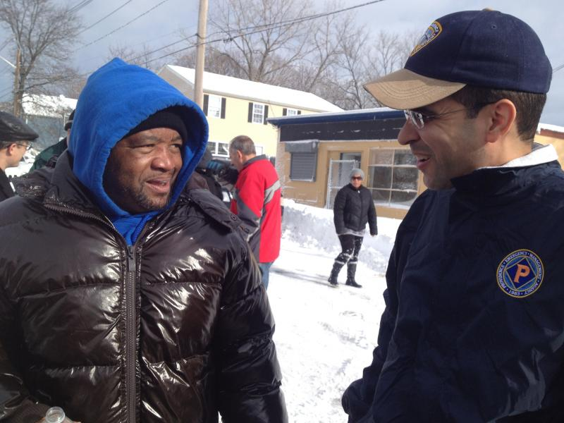 Providence Mayor Angel Taveras talks with a resident about plowing streets