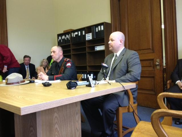 State Police Cpt. James Manni and NRA Lobbyist Darin Goens taking part in a briefing with lawmakers at the Statehouse