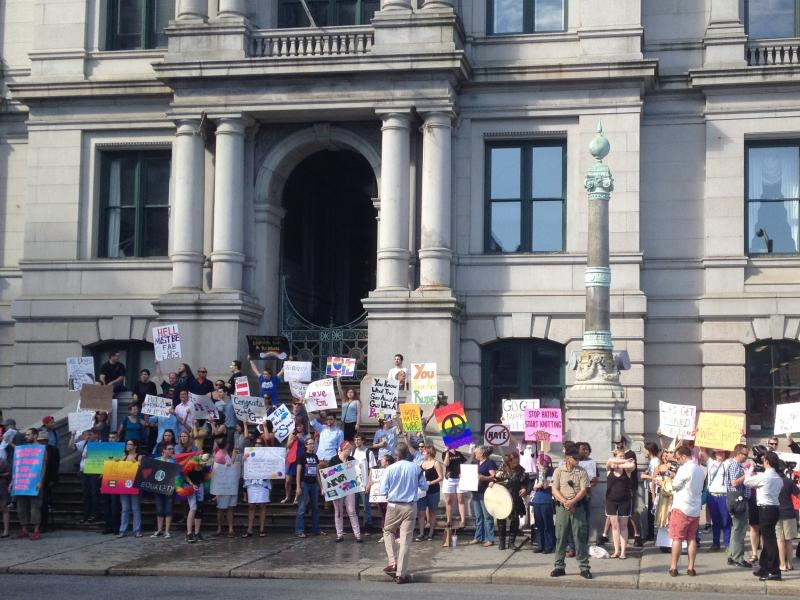 A crowd of supporters rally outside Providence City Hall.