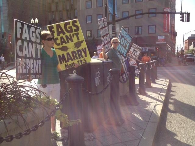 Members of the Westboro Baptist Church protests across the street from Providence City Hall.