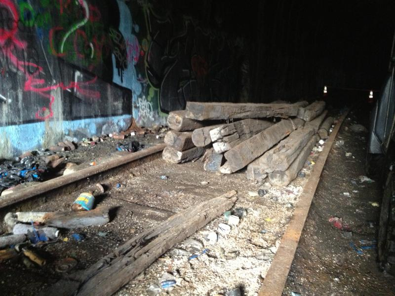 The old tracks run down the mile long tunnel