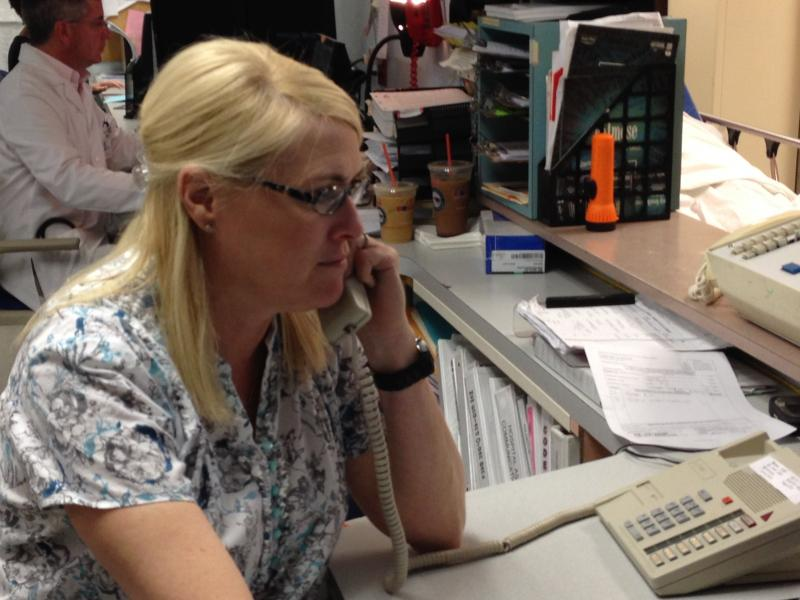 ER nurse and 25-year Landmark veteran Lisa Kuscu on the phone