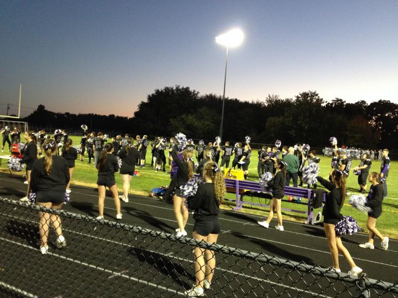 Cheerleaders on the sidelines.