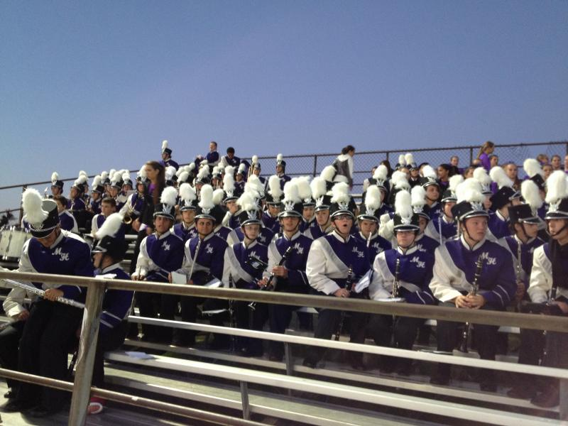 The clarinet section watches the game.