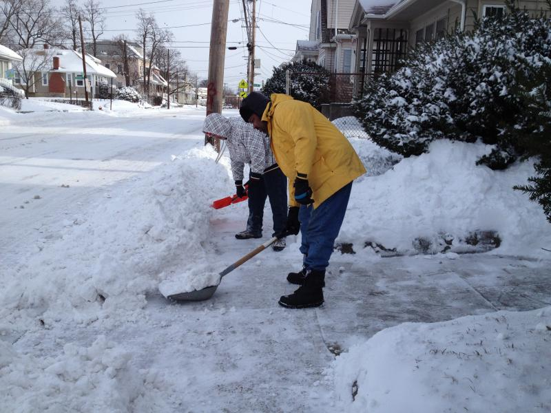 Ricky Rucker and Robert Chico dig out in Cranston