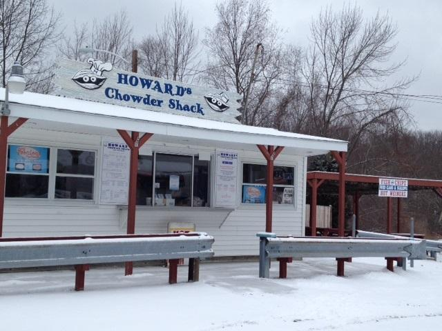 Snow covers a Scituate roadside stop Thursday morning as Rhode Island prepares for up to a foot of snow.