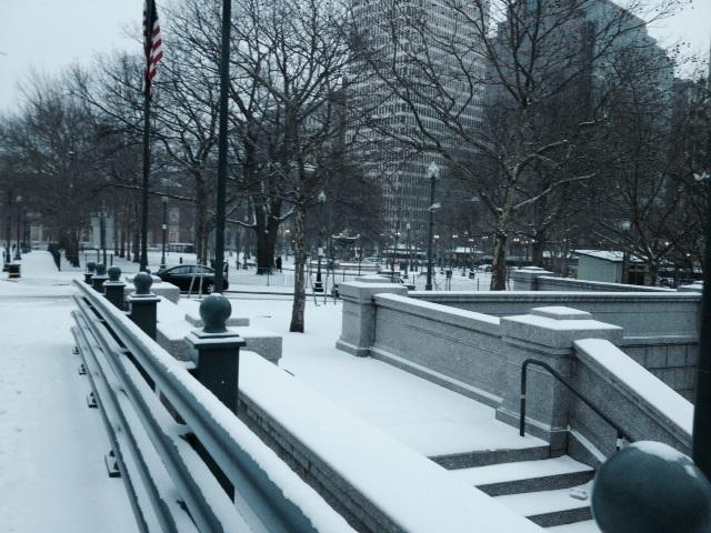Snow starts to build up Thursday morning at Kennedy Plaza in downtown Providence.