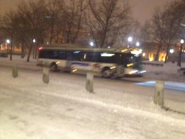 RIPTA buses and snow crews roam the streets of downtown Providence early Friday morning