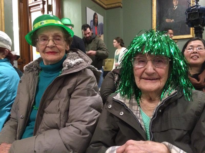 Mimi Anagiro (left) and Josephine Tabis, who turns 98 in a couple of days, celebrate St. Patrick's Day at Providence City Hall.