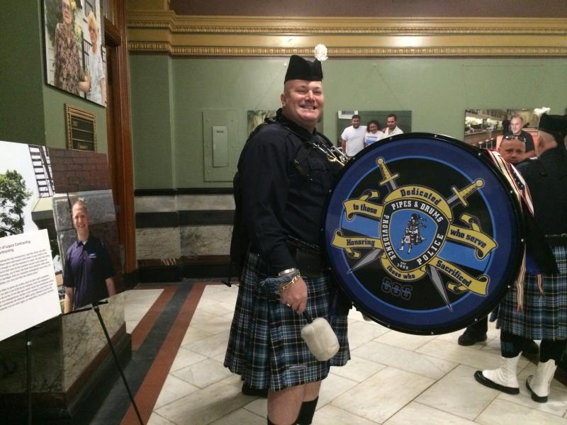 Brian Thornton, drummer for the Providence Police Pipes and Drums, counterbalances the weight of the drum with a 10 pound weight in a backpack.