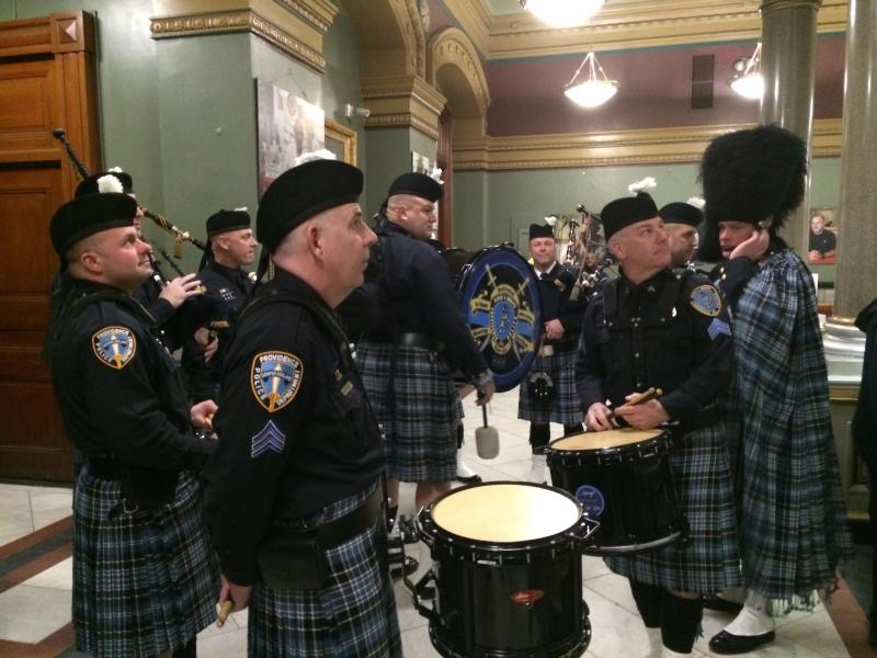 Members of the Providence Police Pipes and Drums, after their opening performance
