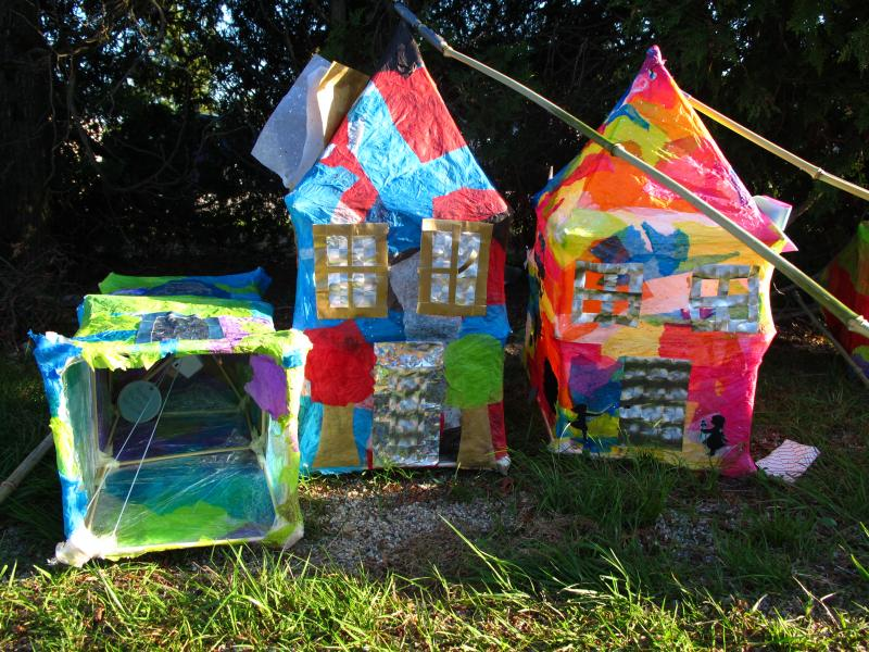 The house lanterns featured in this year's Urban Pond Procession have imagery of what would be found in a neighborhood: kids playing, bicycling, and so on.,