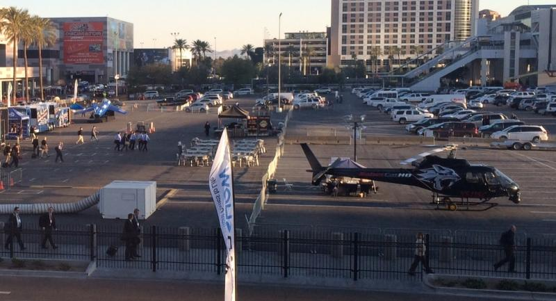 In the parking lot outside the LVCC, there was a fighter jet (left) and a helicopter (right).