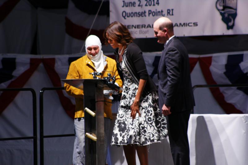 """I declare this keel to be well and truly laid,"" said First Lady Michelle Obama, shortly after she took a look at the welded version of her initials with Electric Boat welder, Michael Macomber (left), and Electric Boat CEO Jeff Geiger."