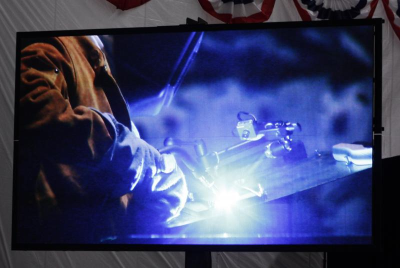 People in the audience were encouraged to witness the welding through a video screen.
