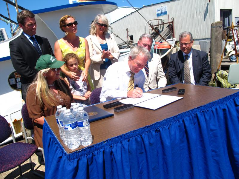 Gov. Lincoln Chafee signed the calamari bill, making calamari the official state appetizer.