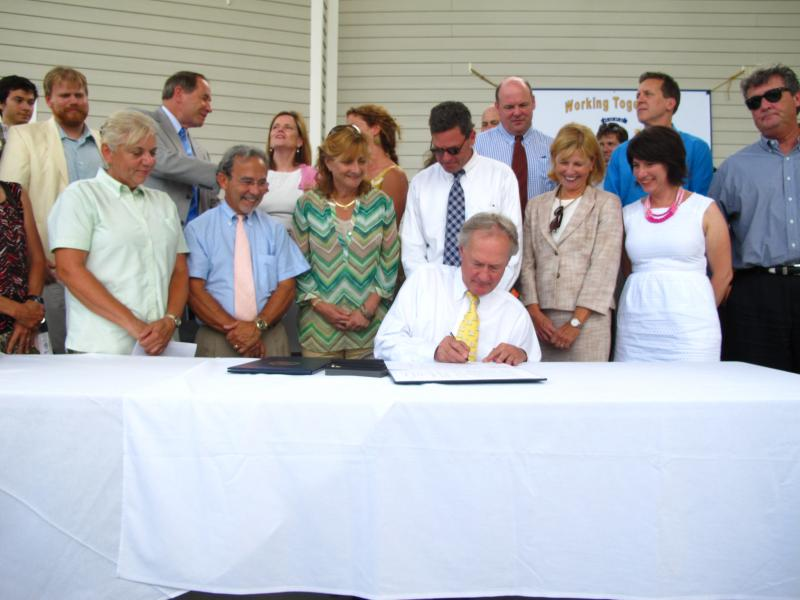 "The ceremonial signing of the ""A Resilient Rhode Island Act"" took place in North Kingstown, one of many places state officials consider vulnerable to damages caused by climate change."